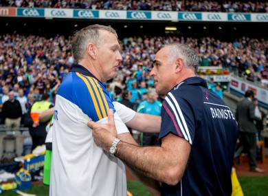 Eamon O'Shea congratulates Anthony Cunningham after Sunday's clash.