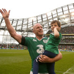 Paul O'Connell waves goodbye to the Aviva Stadium for the last time, with his son Paddy.