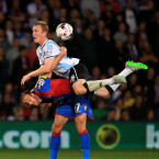 Shrewsbury's Mark Ellis gets to know Glenn Murray of Crystal Palace during their League Cup meeting on Tuesday.