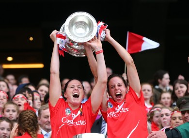 Gemma O'Connor and Orla Cotter lift the O'Duffy Cup.