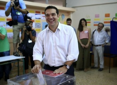 Alexis Tsipras casts his vote at a polling station in Athens.