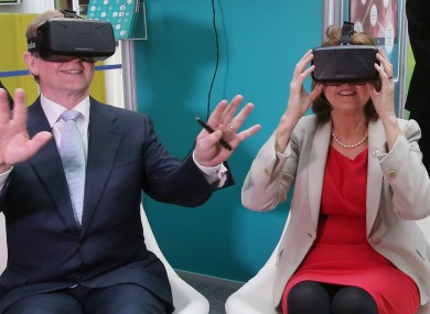 Enda Kenny and Joan Burton trying on some virtual reality goggles.
