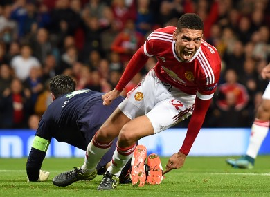Manchester United's Chris Smalling celebrates scoring his side's second goal during the UEFA Champions League Group B match at Old Trafford, Manchester.