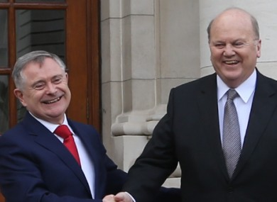 Ministers Howlin and Noonan outside Government Buildings yesterday