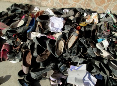Shoes of schoolgirls are seen in Afghanistan's Takhar province, where at least 12 students were killed in a stampede yesterday.