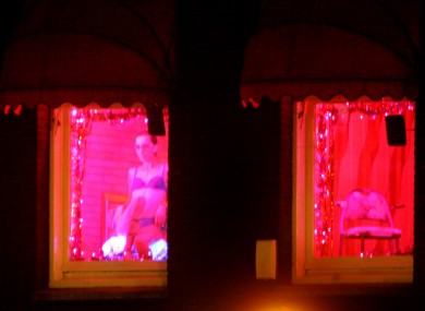 A sex worker in Amsterdam's red light district.