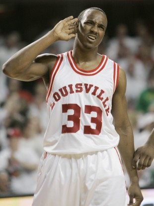 In this March 1, 2009, file photo, then-Louisville's Andre McGee pretends to have trouble hearing the cheers of fans after scoring during the second half of their NCAA college basketball game