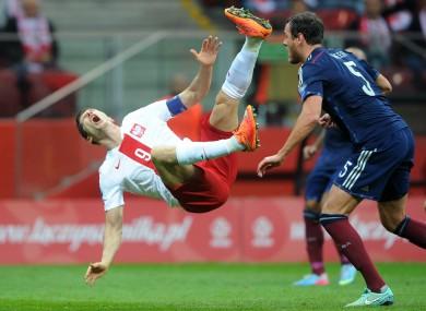 Lewandowski on the receiving end of a challenge from Scotland's Gordon Greer.