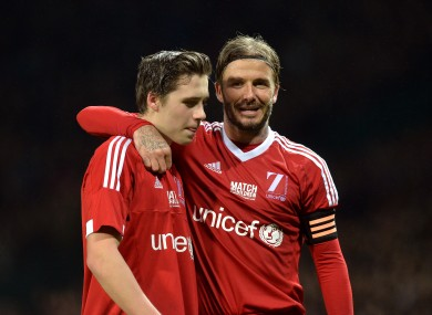 Beckham and his son Brooklyn, who came on as a late substitute.