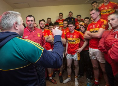 Stephen Rochford congratulates Castlebar Mitchels in their victorious dressing room yesterday.