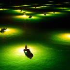 Fishermen wait for glass eels to be drawn to the bright lights they're shining on Japan's Yoshino River. When the eels are close, the fishermen scoop them up. This type of traditional fishing is best done on the darkest nights.<span class=