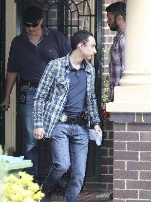 Federal police officers leave the Sydney property.
