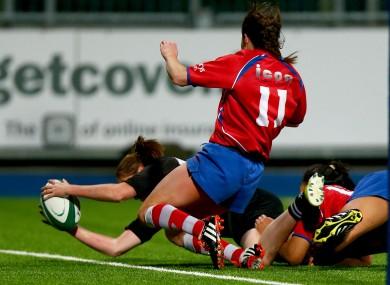 Nora Stapleton reaches out to score.