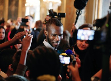 Lassana Bathily talks with children at the Paris city hall just over a week after the attack.