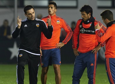 Garry Neville instructs his Valencia players.