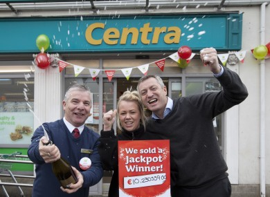 Centra staff celebrate selling a winning lottery ticket.