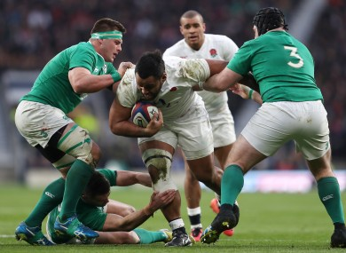 England's Billy Vunipola takes it into contact against CJ Stander (left) and Mike Ross.