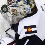 Colorado Avalanche goalie Semyon Varlamov hit in the face with a puck. <span class=