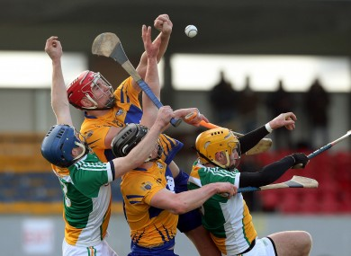 Clare's Peter Duggan rises highest to win possession.