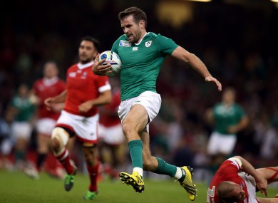 Payne scores against Canada during the Rugby World Cup.