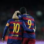 Messi and Suarez embrace.<span class=