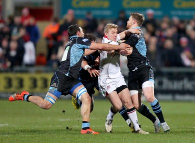 Stuart Olding is tackled by Ryan Wilson, Simone Favaro and Glenn Bryce.