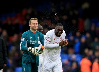 Simon Mignolet sprays Liverpool's Christian Benteke after the final whistle.