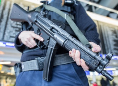 A member of the German federal police secures the terminal area at the airport in Frankfurt am Main, Germany.