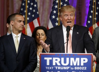 Donald Trump flanked to his right by campaign manager Corey Lewandowski