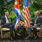 President Barack Obama meets with Cuban President Raul Castro at the Palace of the Revolution.<span class=