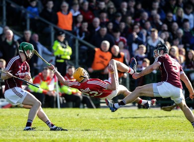 Galway's Adrian Tuohy and David Collins with John Cronin of Cork during Sunday's game in Salthill.