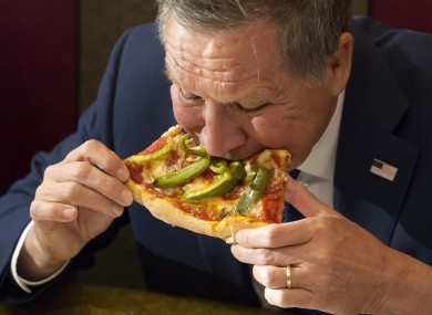 Kasich eats pizza at Gino's Pizzeria in Queens, New York last week.