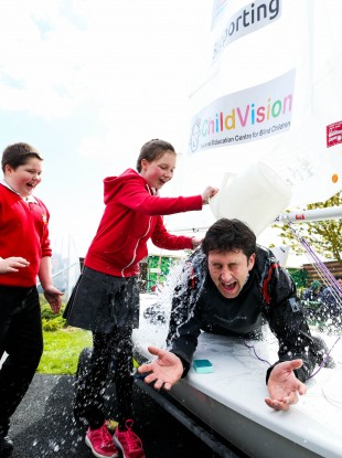 Evan O'Dwyer and Ellen Drewitt from St Joseph's Primary School at ChildVision, Drumcondra pictured with Gary 'Ted' Sargent wet at the launch of the One Wild Ride.