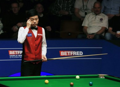 Ding Junhui shows his frustration during the final against Mark Selby on day sixteen of the Betfred Snooker World Championships at the Crucible Theatre.