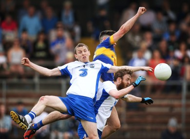 Tipperary's Michael Quinlivan challenges for the ball with Maurice O'Gorman and Thomas O'Gorman of Waterford.
