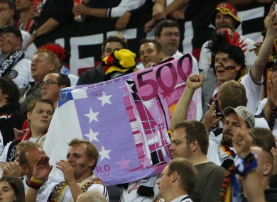 German fans display a fake €500 note during a Euro 2012 match with Greece.