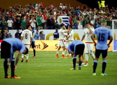 Mexico players celebrate after a Copa America group C soccer match against Uruguay at University of Phoenix Stadium.