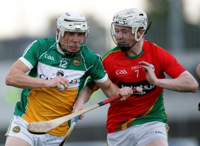Carlow's Eoin Redmond with Ronan Hughes of Offaly