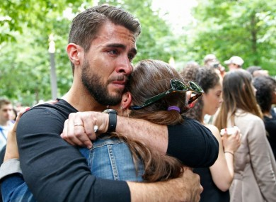 Josh Segarra, who is from Orlando, embraces his wife Brace following a tribute a tribute to the Orlando nightclub shooting victims at the Survivor Tree of the 9/11 Memorial and Museum last Thursday.