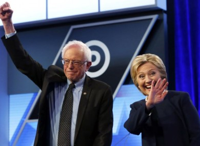 In this 9 March 2016 photo, Sanders and Clinton stand together before the start of a presidential debate at Miami-Dade College in Miami.