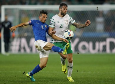 Alessandro Florenzi, left, fights for the ball with Daryl Murphy during the Euro 2016 Group E soccer match between Italy and Ireland.
