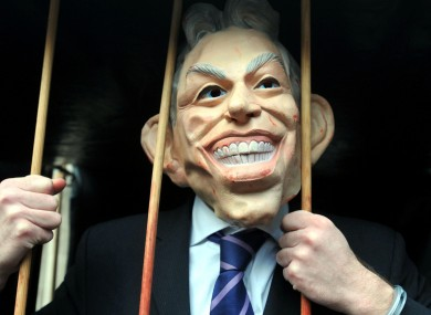 A protester in a Tony Blair mask as the former Prime Minister gave evidence before the inquiry.