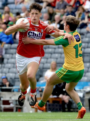 Cork's Colm O'Callaghan in action against Donegal's Peadar Mogan.