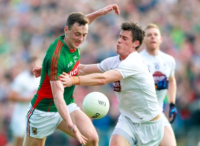 Mayo's Diarmuid O'Connor in action against Kildare's Emmet Bolton.