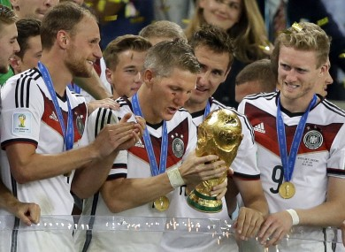 Germany's Bastian Schweinsteiger  prepares to lift the World Cup.