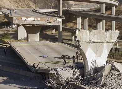 A 1994 file photo of the body of a police officer on the State Highway 14 overpass in Southern California following the Northridge earthquake.
