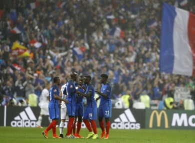 The French players celebrate.