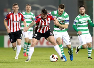 Rory Patterson holds on to possession despite the best efforts of Shamrock Rovers' David O'Connor.