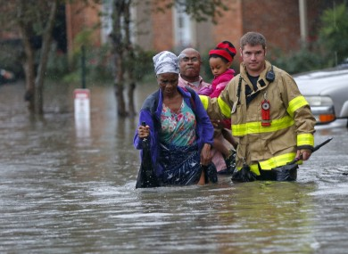 Member of the St George Fire Department helping Baton Rouge residents