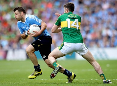 Dublin's Kevin McManamon and Paul Geaney of Kerry compete for the ball.